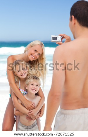 Man taking a photo of his family - stock photo