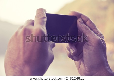 Man taking a photo with his phone  - stock photo