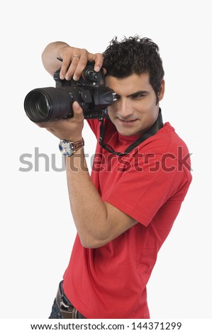 Man taking a picture with a digital camera - stock photo