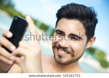 Man taking a picture with his smartphone