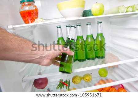 Man taking beer from a fridge - stock photo