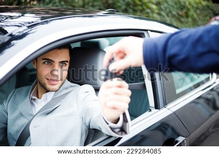 Man taking car key - stock photo