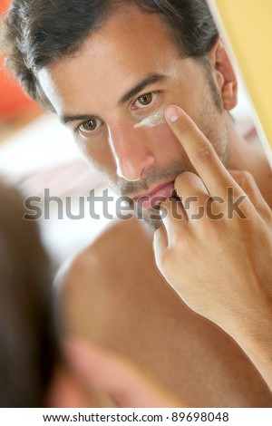 Man taking care of his skin - stock photo