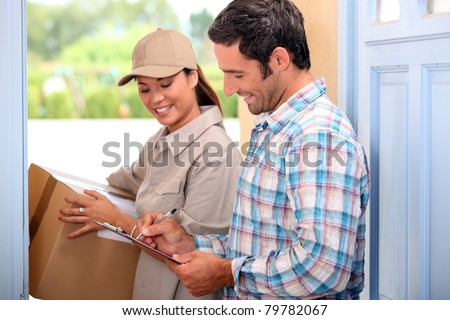 Man taking delivery of a parcel - stock photo