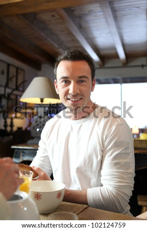 man taking his breakfast - stock photo