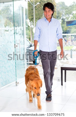 Man taking his cute dog to the vet - stock photo