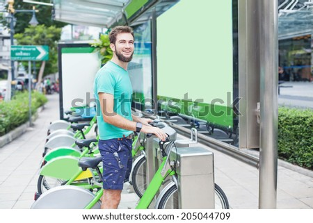 Man taking motorbike for rent - stock photo
