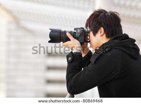 man taking photo