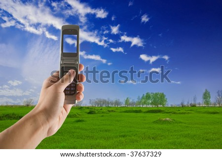 man taking photo with mobile cell phone - landscape orientation - stock photo