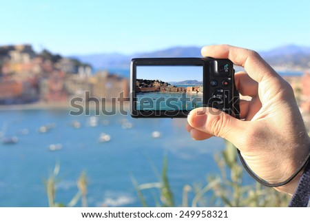 man taking picture of Silence bay to Sestri levante - stock photo
