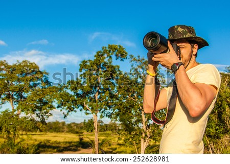 Man taking professional photos of the nature - stock photo
