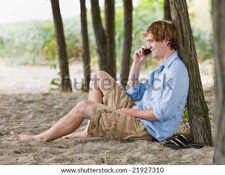 Man talking on cell phone outdoors - stock photo