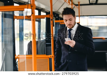 Man Talking on Cell Phone, public transportation, ride a bus - stock photo