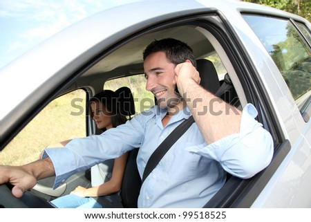 Man talking on mobilephone while driving - stock photo