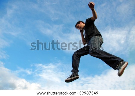 Man talking on phone midair - stock photo