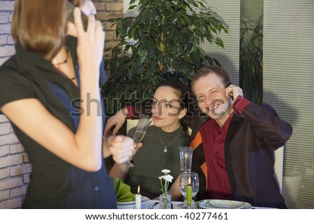 man talking on phone with lover in a restaurant - stock photo