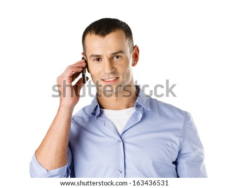 Man talking on the cell phone, isolated on white - stock photo