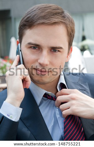 man talking on the phone and staring straight - stock photo