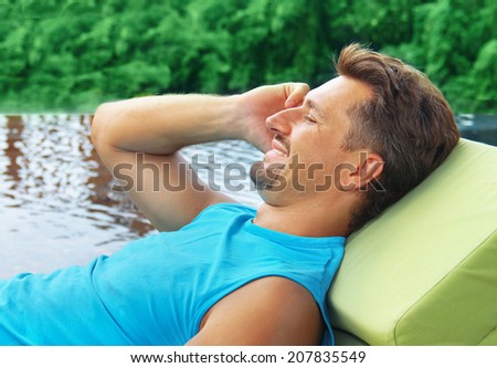man talking on the phone at the pool - stock photo