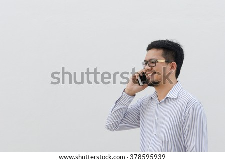 Man talking on the phone happy and smile