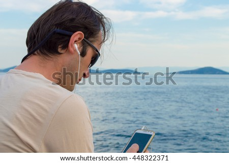 Man Talking on the Phone Near the Sea