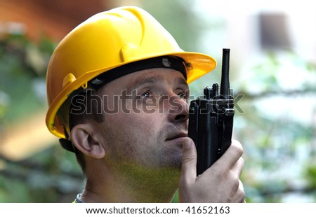 Man talking on the radio - stock photo