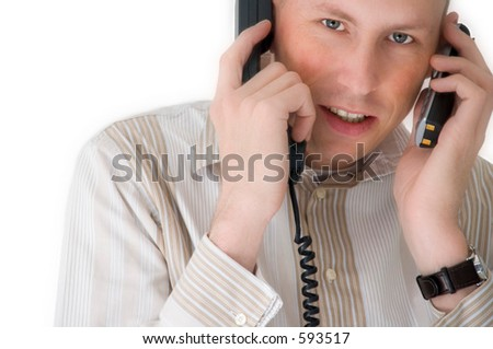 Man talking to two phones simultaneously - stock photo