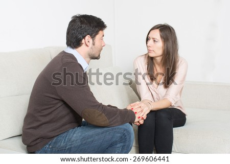 Man talking to woman