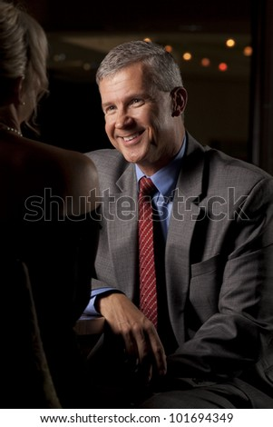 Man Talking with a Woman in a Restaurant - stock photo