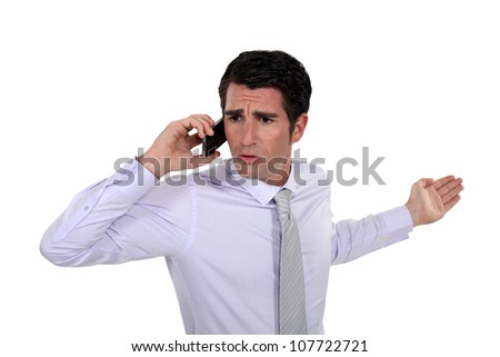 Man talking with his wife on the phone - stock photo
