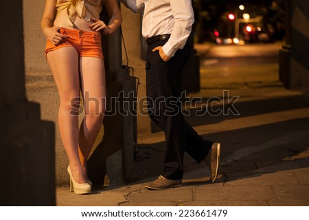 Man talking with prostitute on the street - stock photo
