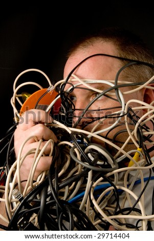Man Tangled in Wires - stock photo