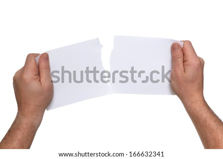 man tearing a piece of blank paper - stock photo