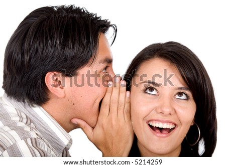 man telling a secret to a girl - she is looking surprised over a white background - stock photo