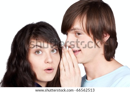 man telling a secret to girl on white background - stock photo