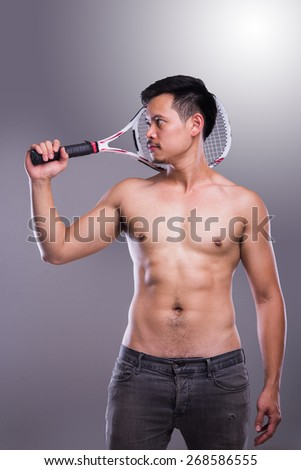 Man Tennis Player Holding Racquet - stock photo