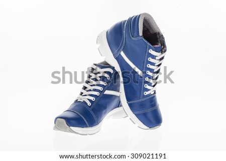 Man tennis shoes in blue leather with white laces on white background