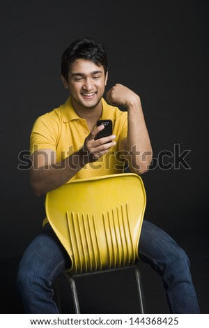 Man text messaging on a mobile phone - stock photo