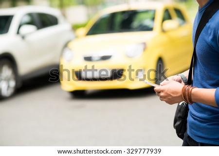 Man text messaging while crossing the road - stock photo