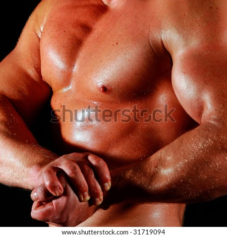 man the body builder shows a biceps and chest muscles