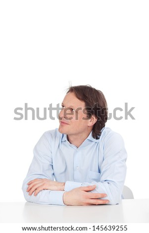 Man thinking about his future and looking up - stock photo
