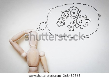 Man thinking about the working process. Abstract image with wooden puppet - stock photo