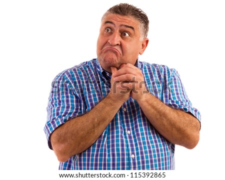 Man thinking hard about a problem holding his hands at chin. - stock photo
