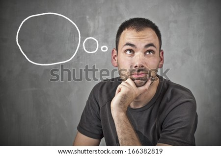 Man thinking on grey background with speech bubbles - stock photo