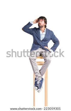 Man thinking over isolated white background - stock photo