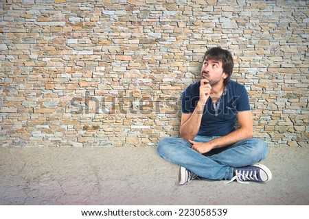 Man thinking over textured background - stock photo