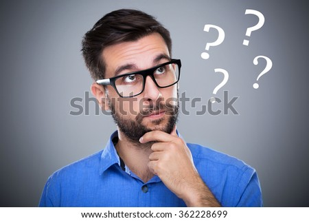 Man thinking with question marks  - stock photo