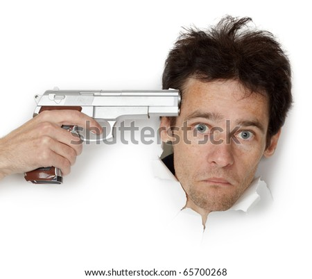 Man threatened with gun isolated on white background - stock photo