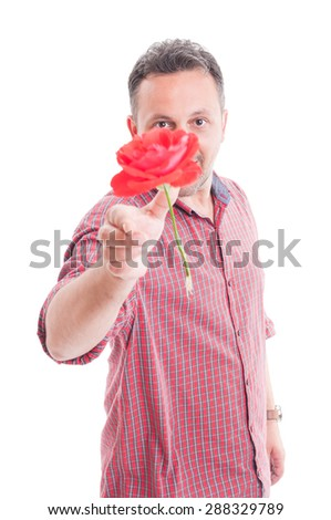 Man throwing a red flower to the camera as a romantic gesture - stock photo