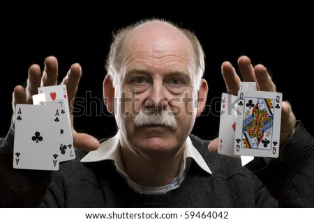Man Throwing cards - stock photo